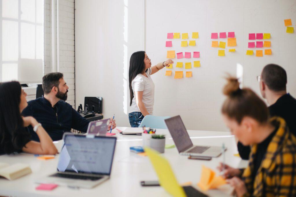 workers strategizing customer engagement marketing